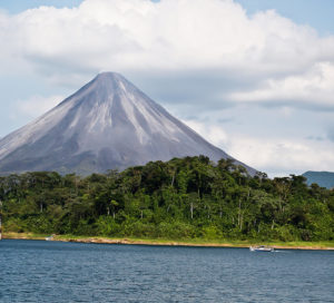 The Arenal volcano in Costa Rica overlooks the tranquil lake that many expats call home.