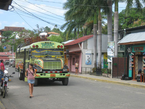 A local bus rumbles through the streets.