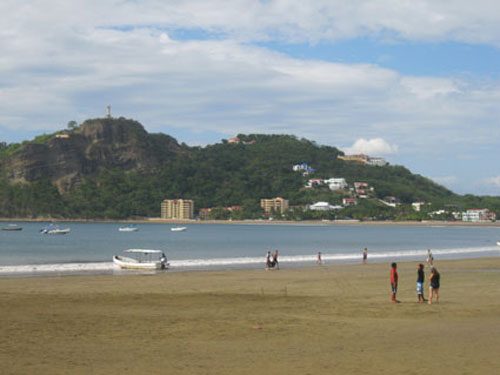 San Juan del Sur's wide and long, curving beach surrounds a protected cove.