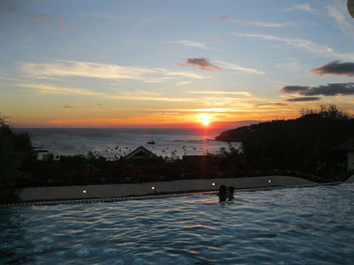 Sunset from the hills above the town. Visit the Pelican Eyes Resort (the best hotel in town) for happy hour to take in this view.
