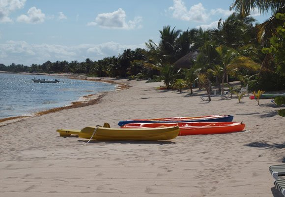 At Soliman Bay, a quiet white-sand beach just north of Tulúm town, you can enjoy kayaking or snorkeling—or just relax under the shade of a palm tree.