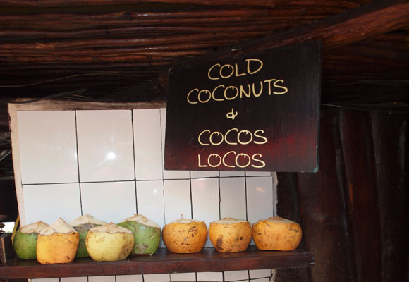 The juice of a fresh coconut is a thirst-quenching treat – and cheap, too.