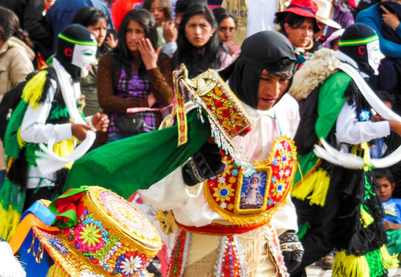 In Cusco's Plaza de Armas (main plaza), hundreds of Peruvians dress in traditional garb and take part in a musical celebration.