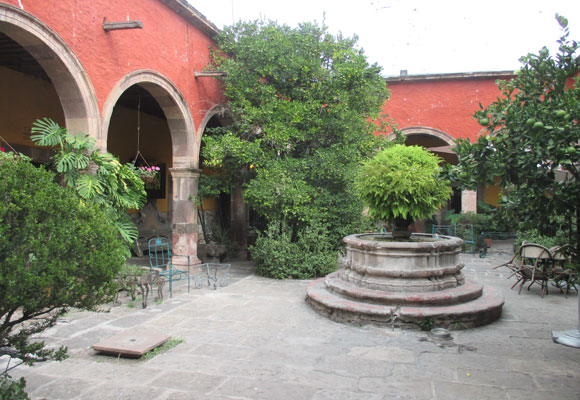 The courtyard of a restored colonial home. Many feature fountains, gardens, and quiet places to sit.