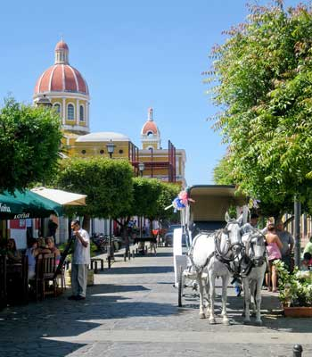 La Calzada is a pedestrian street in the heart of Granada, Nicaragua's historic quarter, lined with bars and restaurants.