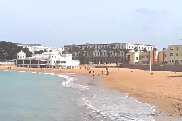 Stroll along Playa de la Caleta (La Caleta beach)