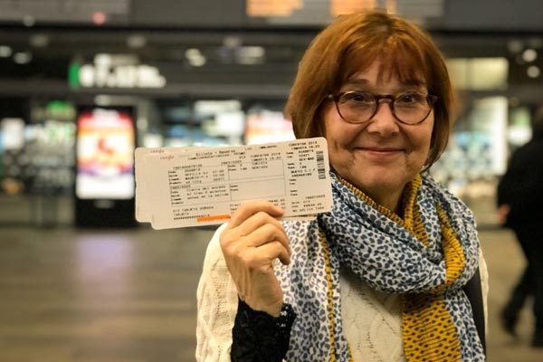 Karen-with-her-train-tickets